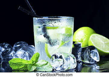 cold mojito - cool Mojito cocktail with fresh limes, mint...