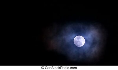 cold moon in the night sky back on soft and dark cloud moving pass