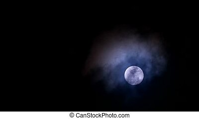 cold moon in the night sky back on soft and dark cloud moving pass1