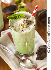 Cold Refreshing Mint Chocolate Chip MilkShake with a Straw