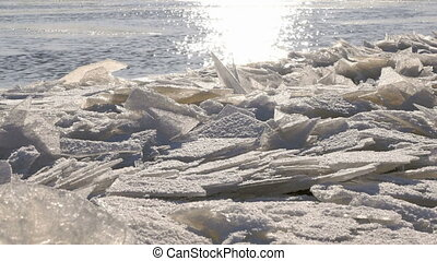 Cold river with a lof of small clusters of ice