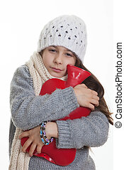 cold sick ill child with hot water bottle.