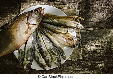 cold smoked fish on wooden background