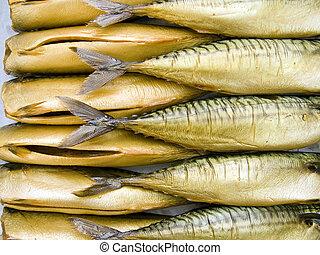 A pile of beautiful big mackerels on a counter