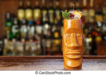 cold summer cocktail in tiki glass