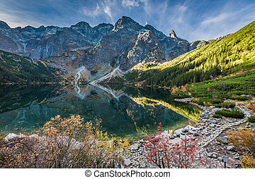 Cold sunrise at lake in the Tatra Mountains in autumn