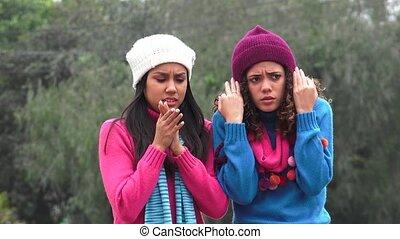 Cold Teen Girls Wearing Sweaters