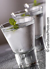 vodka - cold vodka with mint close up shoot