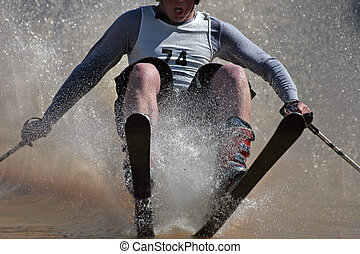 Cold water skiing - A downhill snow skier racing over a ...