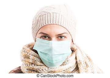 Cold woman wearing surgical mask and knitted warm clothes