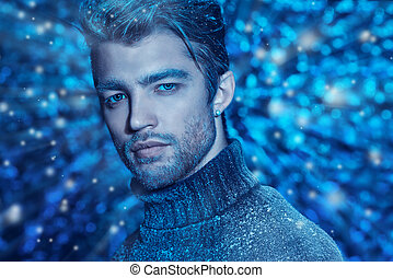 Portrait of a handsome man dressed in winter clothes, covered with frost.