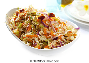 Coleslaw - Serving bowl of coleslaw salad, made with cabbage...