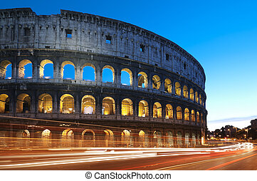 Coliseum in Rome - Italy - Coliseum at night with colorful...