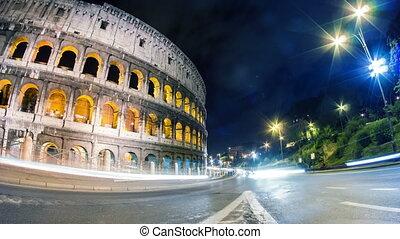 Coliseum night city traffic timelapse