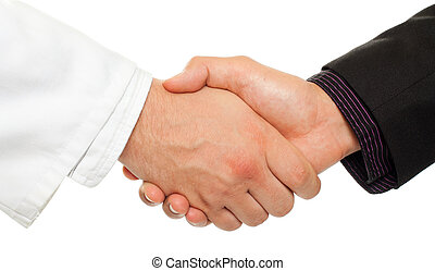 Collaboration - Handshake between a businessman and a...