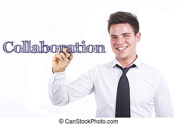 Collaboration - Young smiling businessman writing on transparent surface