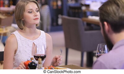 Collaborative romantic dinner in a restaurant