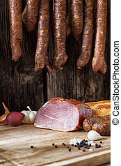 collage of different kinds of meat, smoked sausage and meat