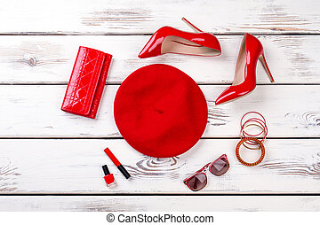 Collage of female red fashion accessories.