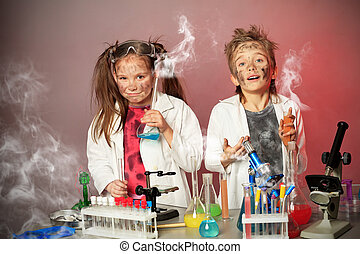 collapse - Two children making science experiments. ...
