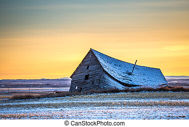 Collapsing Barn in the Prairie Sunset