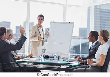 Colleagues asking a question to a businesswoman