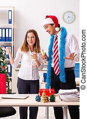 Colleagues celebrating christmas in office