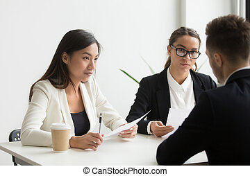 Colleagues discussing business plan in office