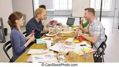 Colleagues enjoying pizza
