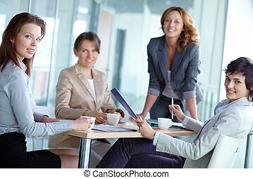 Colleagues - Image of four successful businesswomen looking...