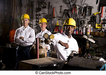 Colleagues in office maintenance area - Multi-ethnic...