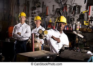 Multi-ethnic colleagues in office maintenance area