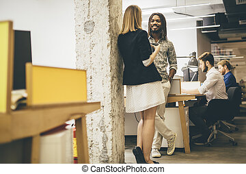 Colleagues in office talking