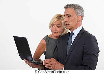 Colleagues looking at computer screen