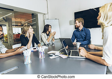 Colleagues sitting at office desk