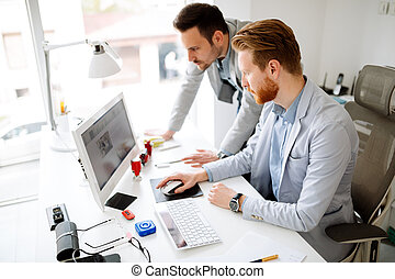 Colleagues working in office