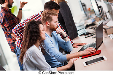 Colleagues working together in company office