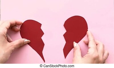 Collect broken heart. The female hand collects the heart...