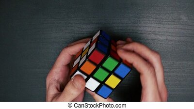collecting a colorful puzzle cube close up.