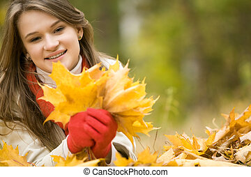 Collecting falling leaves - Portrait of beautiful woman ...