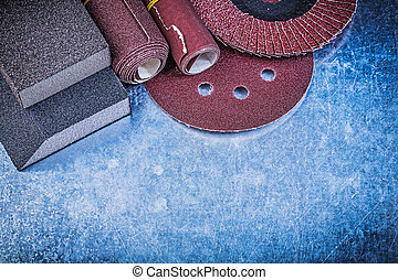 Collection of abrasive tools on scratched metallic background
