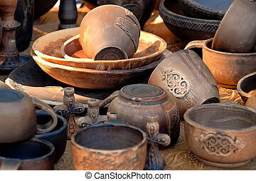 Collection of ancient pottery in beams setting the sun.