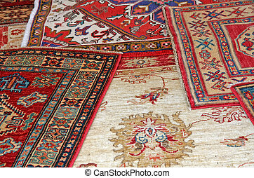 collection of antique oriental carpets expensive on display...