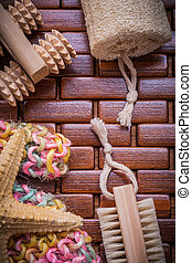 Collection of bath accessories on checked wooden table mat healt