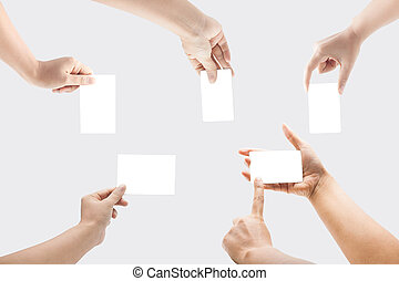 Collection of blank cards in a hand isolated