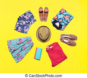 Collection of bright summer clothes.