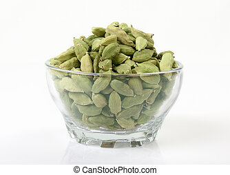 Collection of Cardamom pods on white background