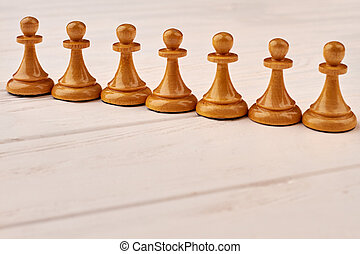 Collection of chess pawns on white background.