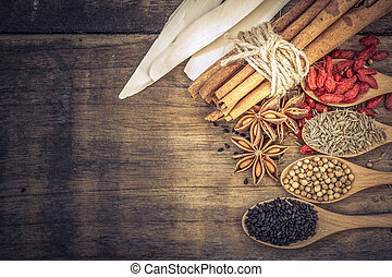 Collection of Chinese herbal ingredient on wooden background