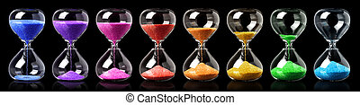 Collection of colorful hourglasses showing the passage of ...